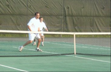 But, it wasn't all work... Me playing tennis with the Oak Ridge Mayor at an annual, city festival.